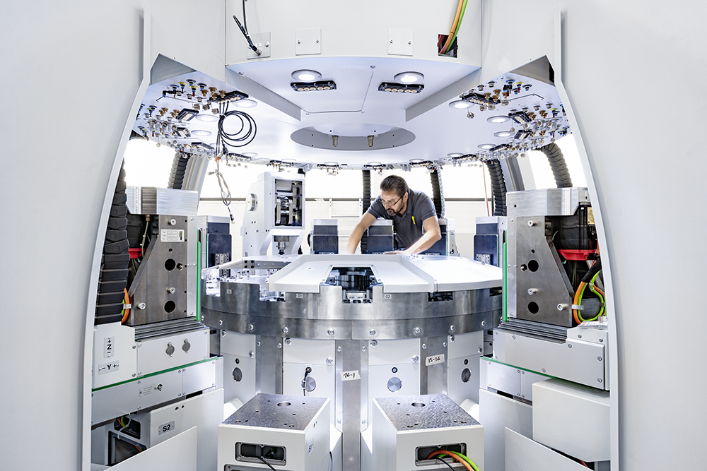 Assembling of a rotary transfer machine MTR216. This type of machine allows you to machine bottom and top face of the part without to flip it. ©ScanderbegSauer