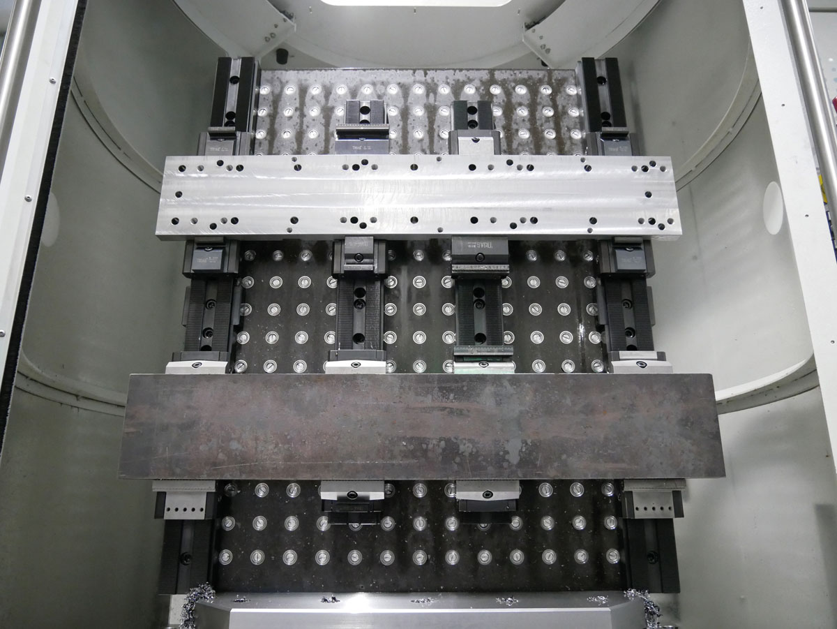 Our vibration damping, light epoxy mineral tombstones in best combination with the modular multiple workholding system powerCLAMP.